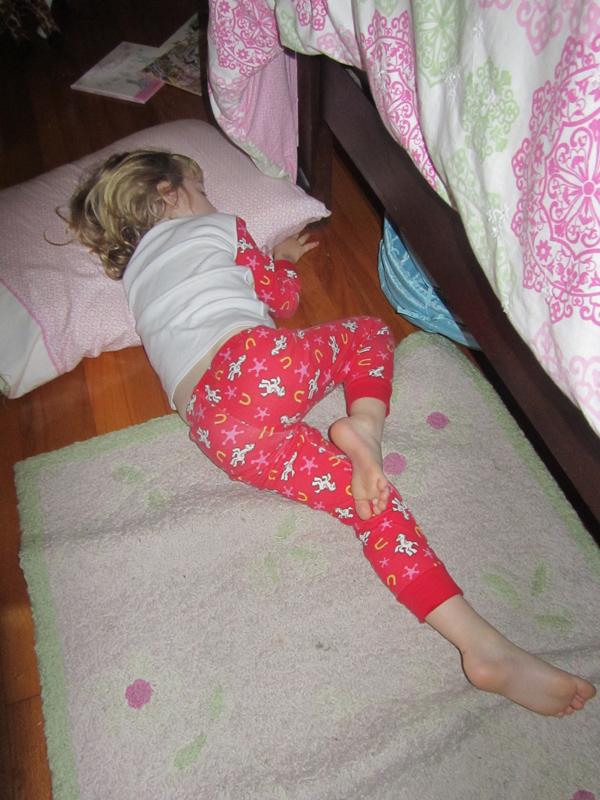 E sleeps on floor