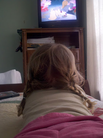 E watches Snow White, braids