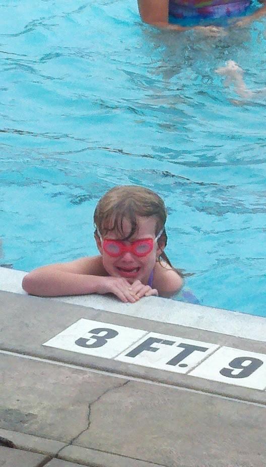E. cries at swimming