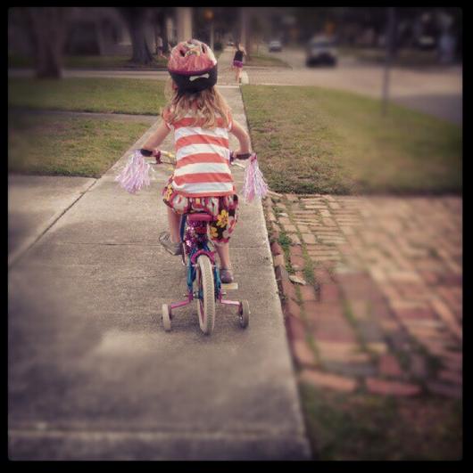 E rides her bike