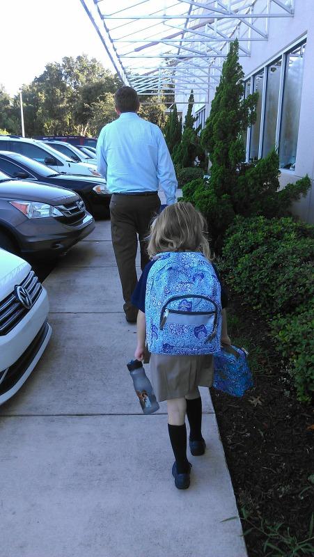 E walks into school
